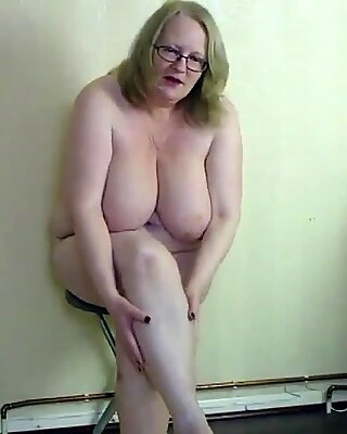 Oiling my huge tits and curvy belly